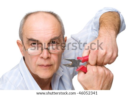 serious man in glasses with pliers isolated on white - stock photo