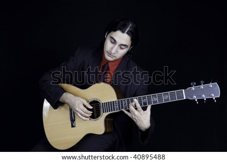 Serious man playing a guitar