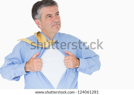 Serious man pulling his shirt with his hands like a superhero - stock photo