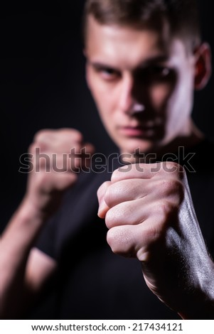 Serious man ready to fight with his fists