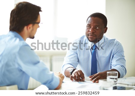 Serious manager talking to a candidate - stock photo