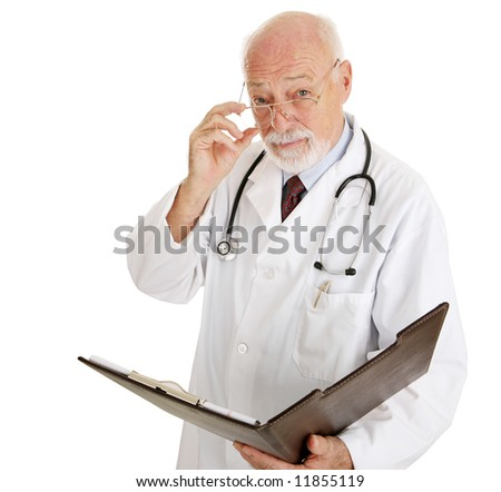 Serious mature doctor wants to discuss your medical history.  Isolated on white. - stock photo