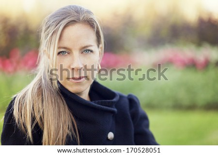 Serious mature woman looking at the camera - stock photo