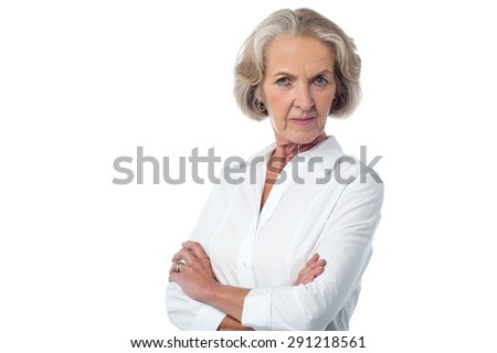 Serious mature woman posing over white - stock photo