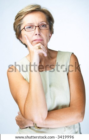 Serious mid adult woman looking at camera - stock photo