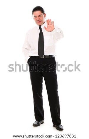 Serious mid aged businessman showing stop gesture over a white background - stock photo