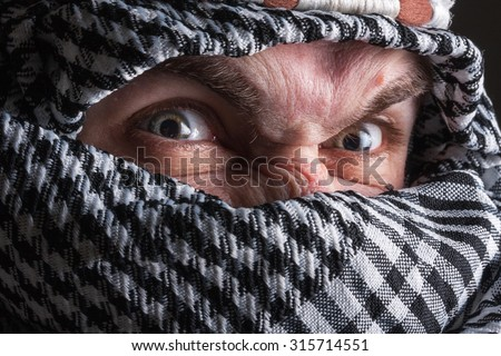 Serious middle eastern man looking to you - stock photo