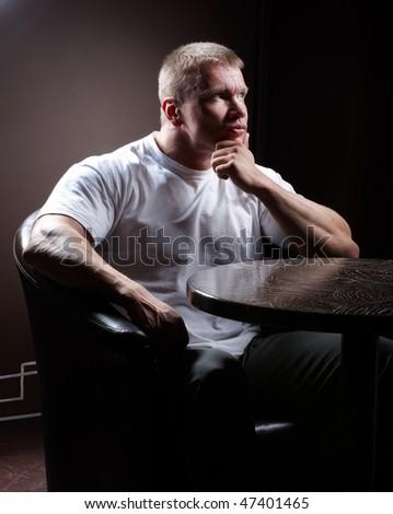 Serious muscular man - stock photo