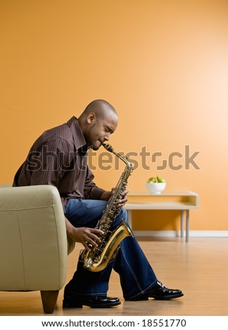 Serious musician performing on saxophone