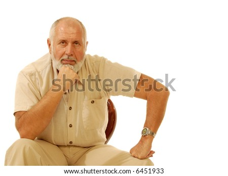 Serious older gentleman sitting in a chair; isolated on white