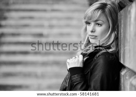 Serious Outdoor Portrait Of Young Woman - stock photo