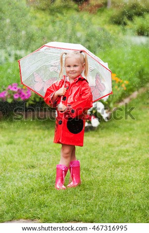 Serious pensive pretty little girl in red raincoat with umbrella walking in park summer, ladybug costume, portrait, rain, outdoor