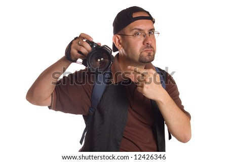 Serious photographer with digital camera taking picture