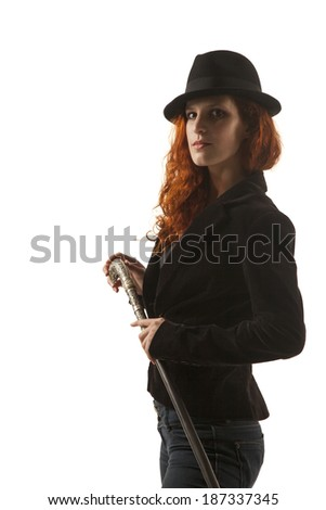 Serious red hair lady with a hat and special walking stick (contrast lightning)