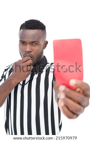 Serious referee showing red card on white background - stock photo