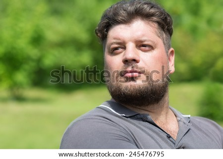 Serious Russian macho looking in the direction of - stock photo