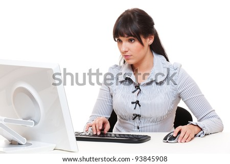 serious secretary sitting on workplace and looking on monitor