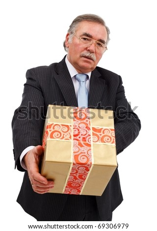 Serious senior business man offering big gift