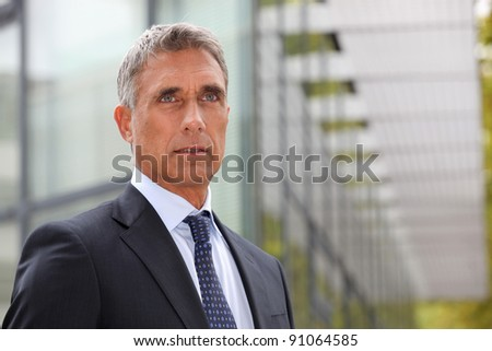 Serious senior businessman - stock photo