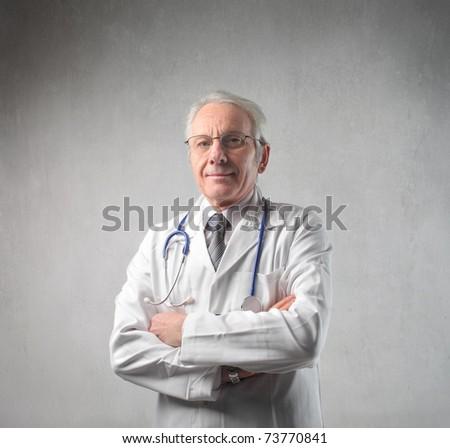 Serious senior doctor - stock photo