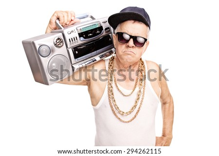 Serious senior rapper holding a ghetto blaster over his shoulder and looking at the camera isolated on white background - stock photo