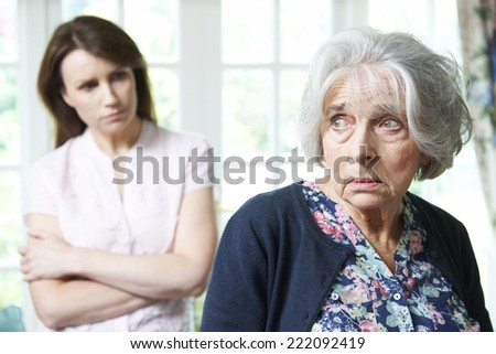 Serious Senior Woman With Adult Daughter At Home - stock photo
