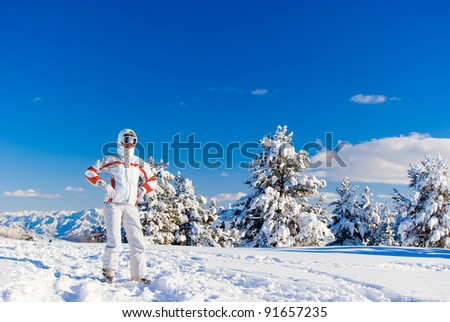 Serious skier in white clothes on the top of mountain. Sarikamis. Turkey