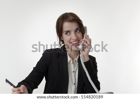 Serious stylish Cheerful pretty businesswoman answering the phone - stock photo