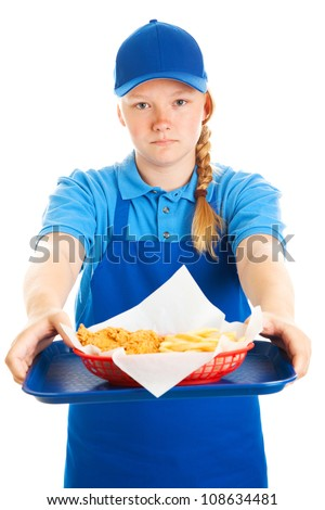 Serious teenage girl serving a fast food meal.  Isolated on white. - stock photo
