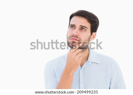 Serious thinking man looking up on white background - stock photo
