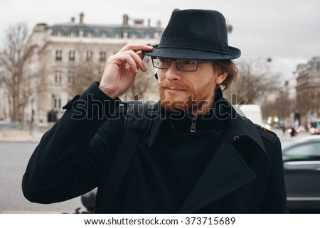 Serious Thoughtful Bearded Man Wearing Hat while Walking on the Street. Headshot Composition. - stock photo