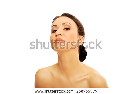 Serious topless woman looking at the camera. - stock photo