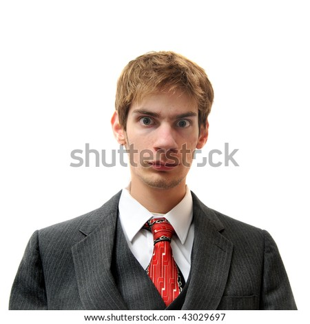 Serious unemotional man in suit isolated on white background. Cold, emotionless, and robotic. - stock photo