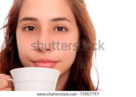 Serious woman carrying a coffee cup to his mouth - stock photo