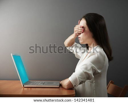 serious woman covering her eyes by hand