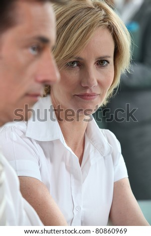 Serious woman in meeting