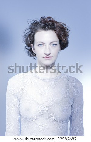 Serious woman on blue background, indoors - stock photo