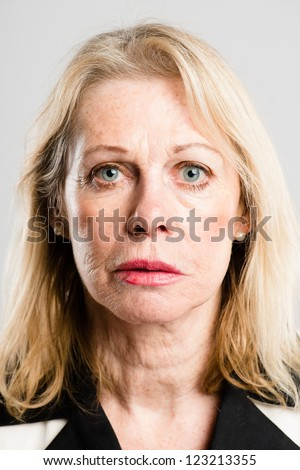 serious woman portrait real people high definition grey background - stock photo