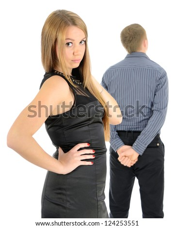 Serious woman with man in the background. - stock photo