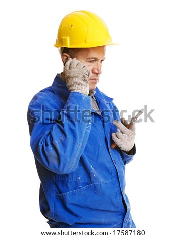 serious worker talking on the mobile phone. isolated on white - stock photo