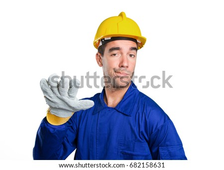 Serious worker with keep calm gesture on white background