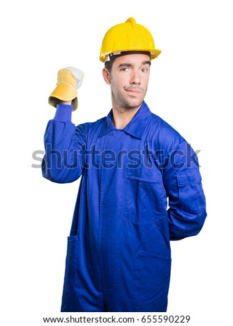 Serious workman challenging on white background