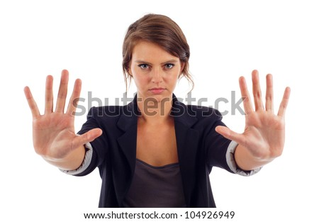 Serious young attractive woman with her hand signaling stop isolated over white background - stock photo