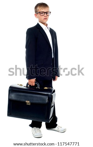 Serious young business boy holding office briefcase. Full length shot - stock photo