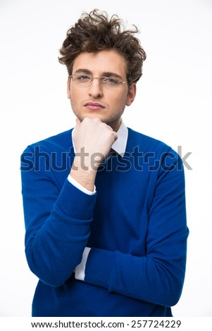 Serious young business man in glasses over gray background - stock photo