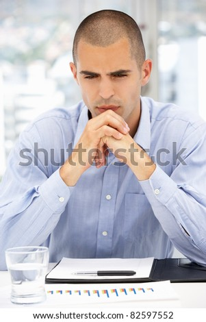 Serious young businessman - stock photo