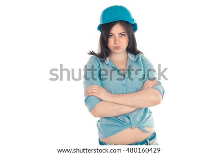 serious young female builder with crossed hands looking at the camera isolated on white background