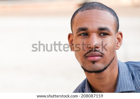 Serious Young Handsome Black Man. Copy space. - stock photo
