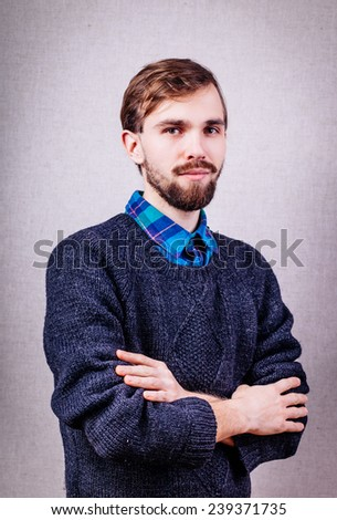 serious young man in blue sweater - stock photo