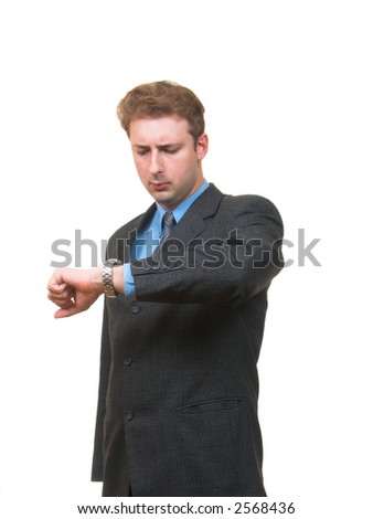 Serious young man in business suit looking at his watch isolated on white - stock photo